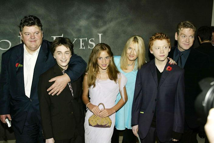 """LONDON - NOVEMBER 3: Actors Robbie Coltrane, Daniel Radcliffe, Emma Watson, Author Jk Rowling, Rupert Grint and Kenneth Branagh arrive for the world premiere of """"Harry Potter and the Chamber of Secrets"""" at the Odeon Leicester Square November 3, 2002 in London. (Photo by Dave Hogan/Getty Images)"""