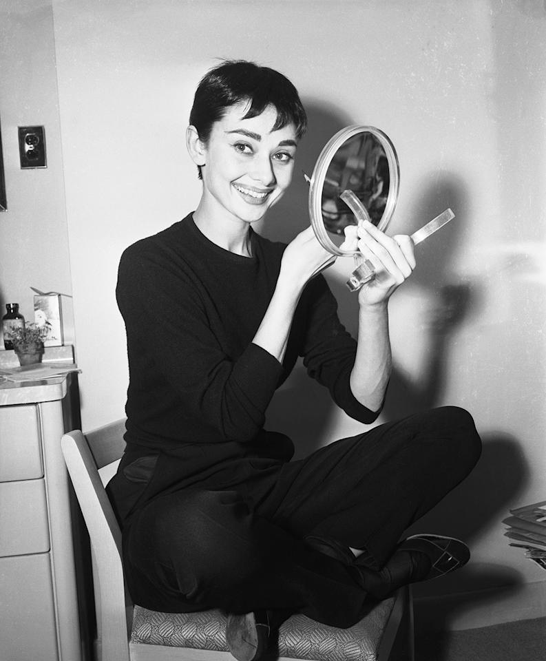 <p>In her dressing room at the 46th Street Theater, applying makeup for her role in the play <em>Ondine</em>, 1954.</p>