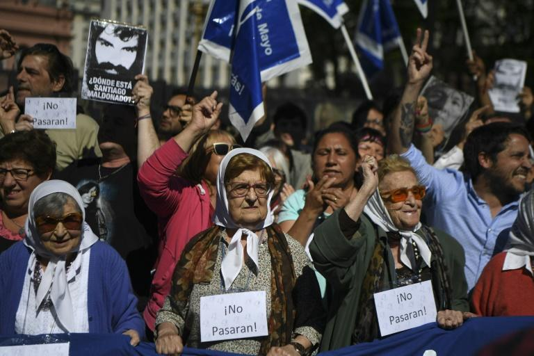 The octogenarian Mothers of Plaza de Mayo, heads covered with white handkerchieves, are joined by others in a protest 40 years after beginning their struggle to identify children stolen by Argentina's former dictatorship
