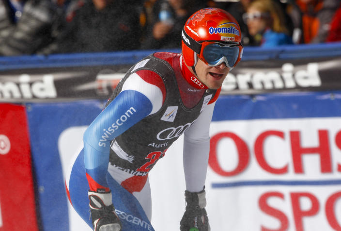 Patrick Kueng, of Switzerland, catches his breath in the finish arena during the men's World Cup downhill ski race in Beaver Creek, Colo., on Friday, Nov. 30, 2012. Kueng placed 13th in the race. (AP Photo/Alessandro Trovati)