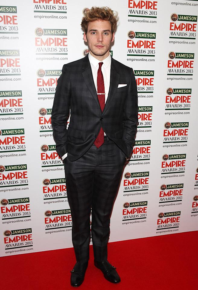 "Are you feeling the checkered suit and red tie Sam Claflin sported at the Jameson Empire Awards? More importantly, are you feeling him as Finnick in the upcoming ""Hunger Games"" sequel, ""Catching Fire""? (3/24/2013)"