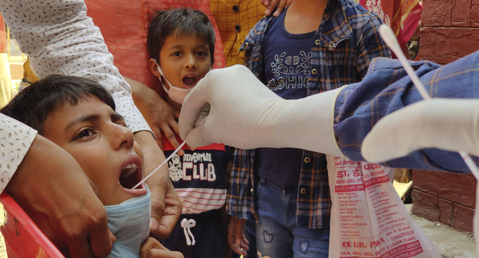A child is swabbed for a Covid test in India.
