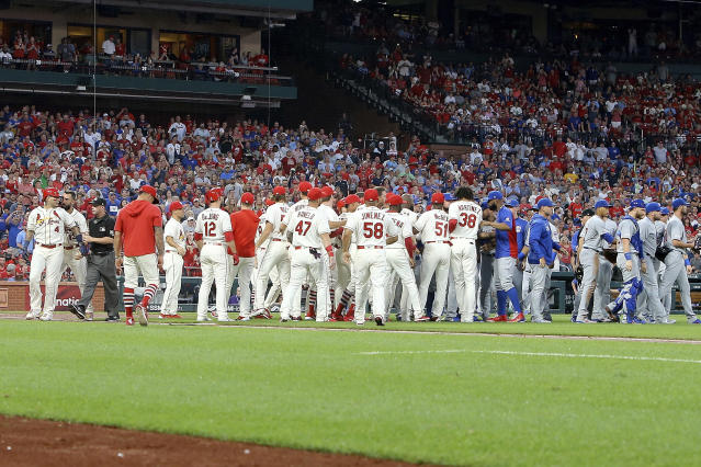 St. Louis Cardinals' Yadier Molina (4), far left, is pushed from a bench-clearing argument by teammate Matt Carpenter after he was hit by pitch during the second inning of a baseball game against the Chicago Cubs, Saturday, Sept. 28, 2019, in St. Louis. (AP Photo/Scott Kane)