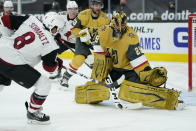 Vegas Golden Knights goaltender Marc-Andre Fleury (29) blocks a shot by Arizona Coyotes center Nick Schmaltz (8) during the third period of an NHL hockey game Wednesday, Jan. 20, 2021, in Las Vegas. (AP Photo/John Locher)