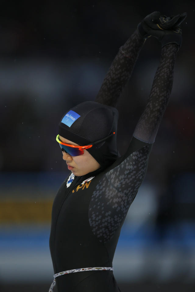 Miho Takagi of Japan stretches prior to competing during the women's 1,500 meters race at the World Championships Speedskating Allround at the Olympic stadium in Amsterdam, Netherlands, Saturday, March 10, 2018. (AP Photo/Peter Dejong)
