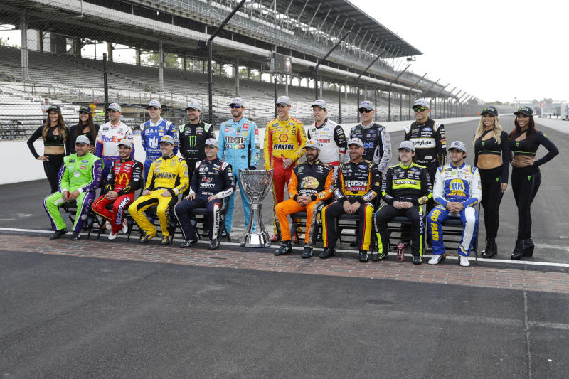 Drivers who qualified the NASCAR Cup Series playoff pose on the the start/finish line following the Brickyard 400 auto race at Indianapolis Motor Speedway, Sunday, Sept. 8, 2019, in Indianapolis. (AP Photo/Darron Cummings)