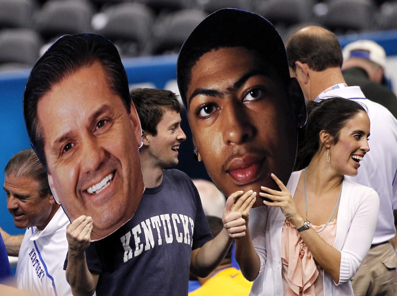 Kentucky fans hold up gaint faces of Kentucky head coach John Calipari, left and forward Anthony Davis, before the first half of the NCAA Final Four tournament college basketball championship game against Kansas, Monday, April 2, 2012, in New Orleans. (AP Photo/Bill Haber)