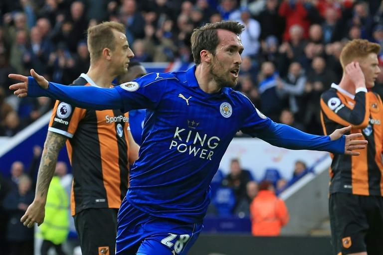 Leicester City's defender Christian Fuchs celebrates after scoring their first goal during the English Premier League football match against Hull City March 4, 2017