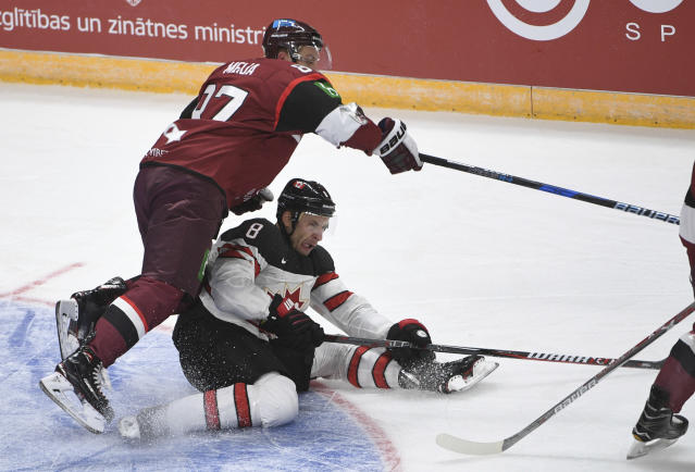 Wojtek Wolski will lead Canada's two-time defending gold medal men's hockey team into Pyeongchang. (AP Photo/Roman Koksarov)