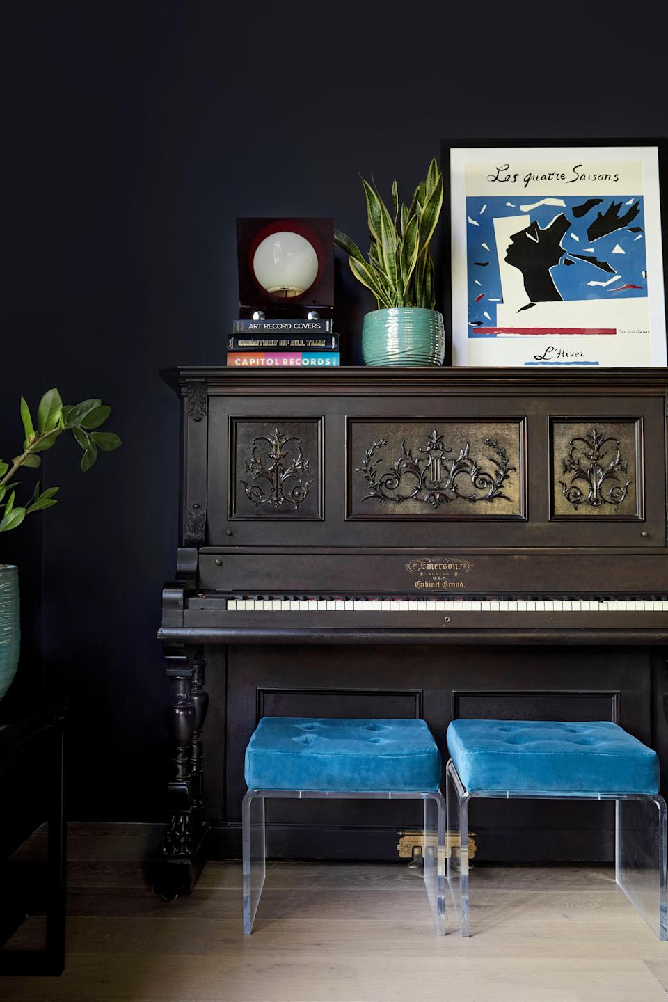 """Songwriting is storytelling, and I think that the instruments you use to tell the story add so many elements and tones to what you're making,"" says Miley, who insisted on including this upright piano from the early 1900s in her sitting room. ""I'm not the first person to write a song about being brokenhearted, and I'm not the first one to write a song about getting too drunk last night. The stories that were told on the keys before I told my own—there's a presence to them, there's a tone, there's a ring. I think it's an important quality that adds a lot of texture to the music that you're making currently."""