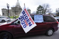 Motorist's participate during a drive-by rally to certify the presidential election results near the Capitol building in Lansing, Mich., Saturday, Nov. 14, 2020. Michigan's elections board is meeting to certify the state's presidential election results. (AP Photo/Paul Sancya)