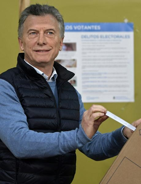 Pro-business President Mauricio Macri turned to a Peronist running mate for his re-election bid, but he was still crushed in Sunday's party primaries (AFP Photo/JUAN MABROMATA)