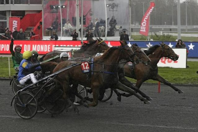 Jean-Michel Bazire driving Belina Josselyn (12) home last year (AFP Photo/Geoffroy VAN DER HASSELT)