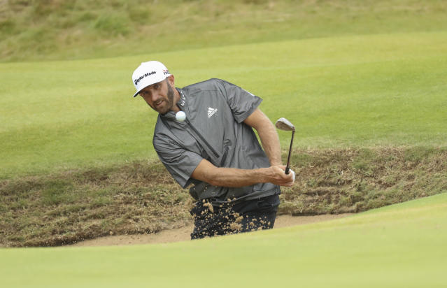 Dustin Johnson of the United States plays out of a bunker on the 15th green during a practice round ahead of the start of the British Open golf championships at Royal Portrush in Northern Ireland, Wednesday, July 17, 2019. The British Open starts Thursday. (AP Photo/Peter Morrison)