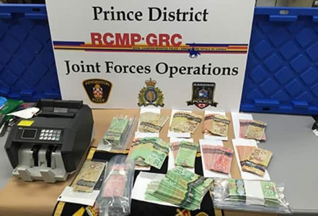 Items seized included about 80 grams of cocaine and more than $60,000 in cash.