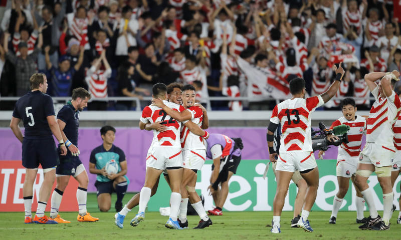 Japan players celebrate after defeating Scotland 28-21 in their Rugby World Cup Pool A game at International Stadium in Yokohama, Japan, Sunday, Oct. 13, 2019. (AP Photo/Christophe Ena)