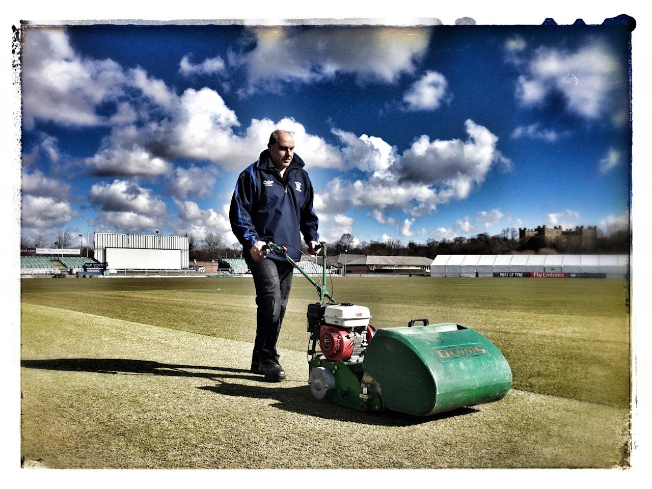 CHESTER-LE-STREET, ENGLAND - APRIL 3: (Editors note: This image was created using an iPhone and saturation filters) Head groundsman Dave Measor of Durham CCC mows the grass during a pre-season photocall at The Riverside on April 3, 2013 in Chester-le-Street, England. (Photo by Paul Thomas/Getty Images)