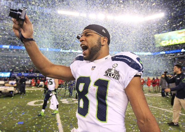 Seattle Seahawks' Golden Tate celebrates after the NFL Super Bowl XLVIII football game against the Denver Broncos Sunday, Feb. 2, 2014, in East Rutherford, N.J. The Seahawks won 43-8. (AP Photo/Jeff Roberson)
