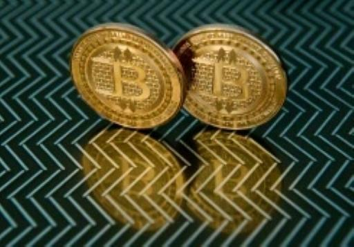 Bitcoin chalks up new record as it charges past $14,000