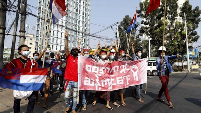 Protesters flash the three-finger salute in Yangon, Myanmar