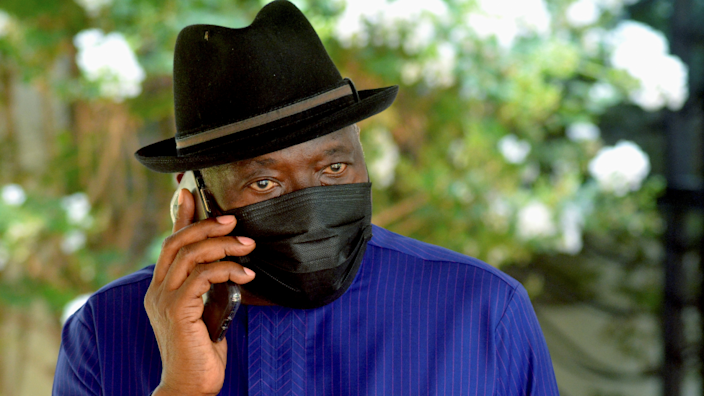 Nigeria's ex-President Goodluck Jonathan wearing a black hat and face mask talking on a phone in Bamako, Mali - Wednesday 26 May 2021