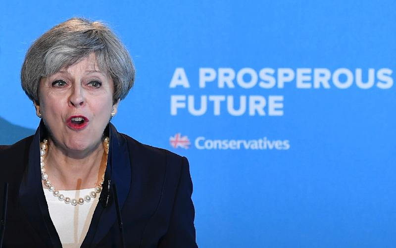 Britain's Prime Minister Theresa May speaks during an event to launch the Conservative Party general election manifesto in Halifax in northern England on May 18, 2017