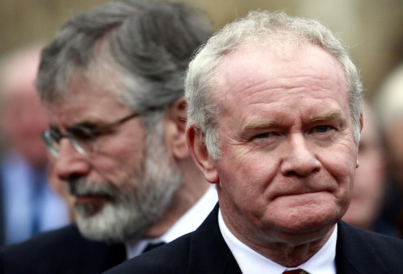 FILE - In this Wednesday, Nov. 27, 2013, file photo Sinn Fein's Martin McGuinness, right, and Gerry Adams attend the funeral of Catholic Priest Alec Reid Clonard Monastery, West Belfast, Northern Ireland. Relations between Britain and Ireland have experienced many highs and lows in a century marked by rebellion, terror and treaties. (AP Photo/Peter Morrison, File)