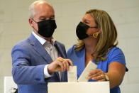 Conservative Leader Erin O'Toole and his wife Rebecca O'Toole cast their ballots for the Canadian general federal election in Bowmanville, Ont. on Monday, Sept. 20, 2021. (Adrian Wyld/The Canadian Press via AP)