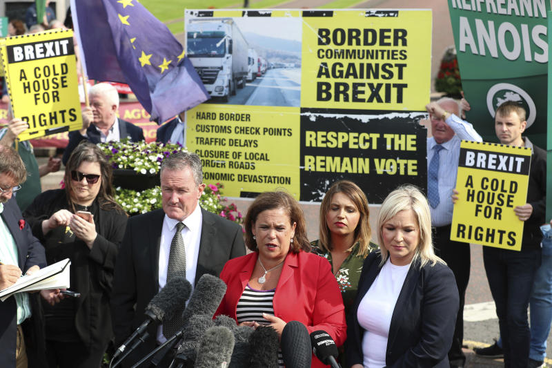 Northern Ireland's Sinn Fein party president Mary Lou McDonald speaks to the media with Sinn Fein Foyle MP Elisha McCallion, second from right, and Sinn Fein deputy leader Michelle O'Neill, right, after their meeting with Britain's Prime Minister Boris Johnson at Stormont House in Belfast, Wednesday July 31, 2019.  Northern Ireland, as part of the UK, has an invisible land border with the Republic of Ireland in Europe, which is a main stumbling block to a Brexit deal, and Johnson depends on various Northern Irish political parties for his working majority in parliament. (Liam McBurney/PA via AP)