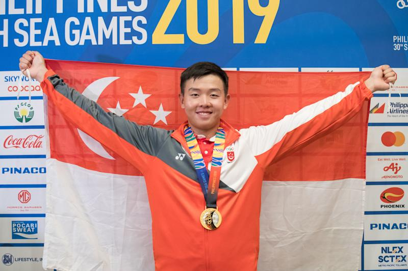 Singapore sailor Ryan Lo wins gold in the men's laser standard at the SEA Games. (PHOTO: Sport Singapore / Dyan Tjhia)