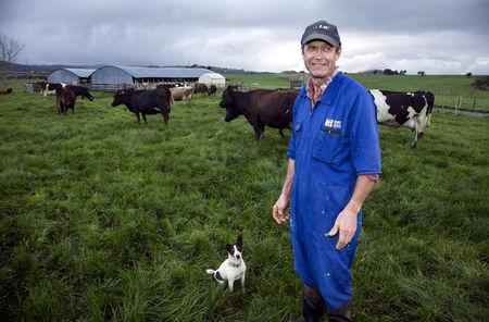 FILE PHOTO - Dairy farmer Keith Trotter stands in a field amongst his herd of cows on his farm in the town of Matakana, located north of Auckland, New Zealand