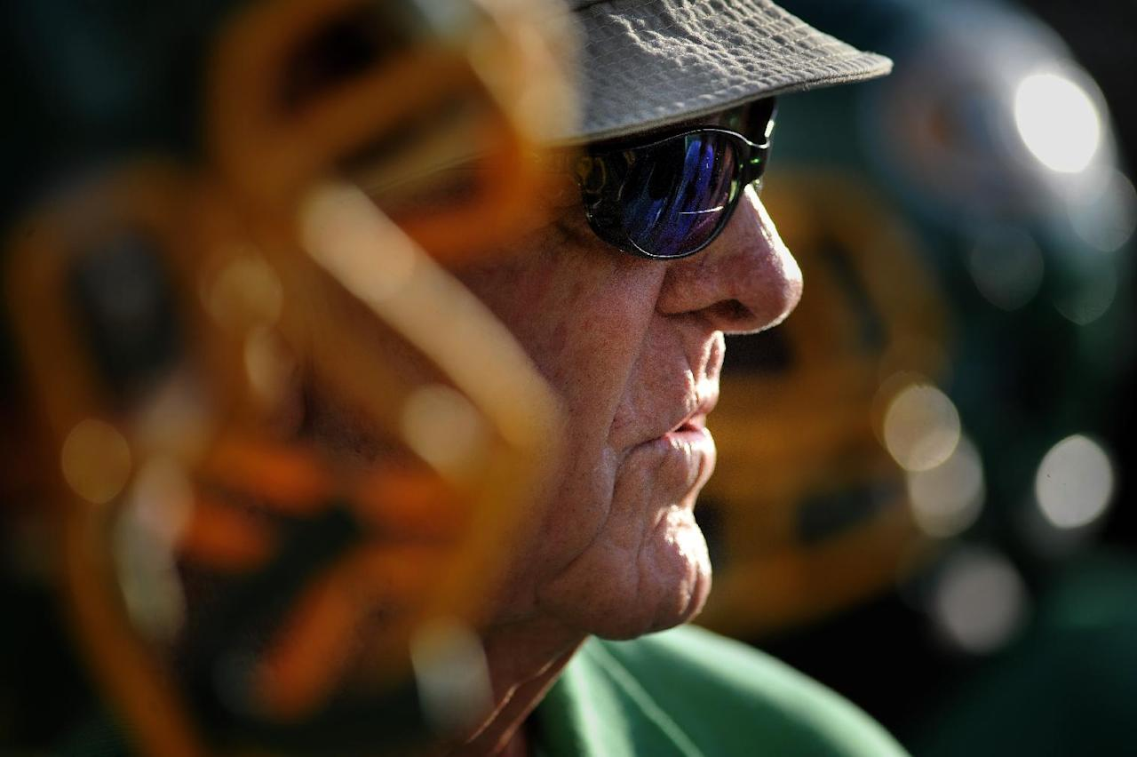 In this Oct. 24, 2012 photo, Summerville High School coach John McKissick coaches his team at the school's practice field in Summerville, S.C. McKissick is on the verge of his latest milestone in a career full of them, a game away from his 600th football win. (AP Photo/Stephen Morton)