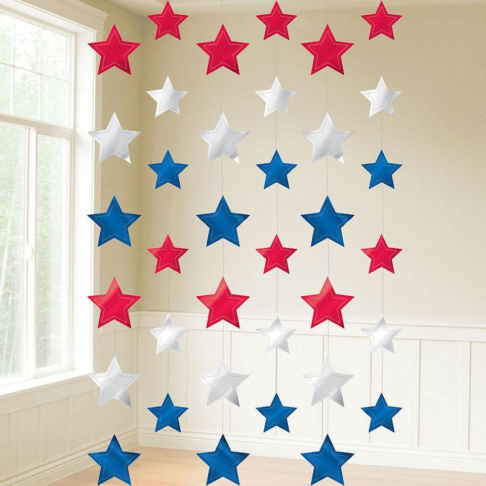 """<p>partycity.com</p><p><strong>$3.99</strong></p><p><a href=""""https://go.redirectingat.com?id=74968X1596630&url=https%3A%2F%2Fwww.partycity.com%2Fpatriotic-red-white-and-blue-stars-string-decorations-6ct-97494.html%3Fcgid%3D4th-of-july-decorationshttps%253A%252F%252Fwww.partycity.com%252Fpatriotic-red-white-and-blue-stars-string-decorations-6ct-97494.html%253Fcgid%253D4th-of-july-decorations&sref=https%3A%2F%2Fwww.womansday.com%2Fhome%2Fdecorating%2Fg2441%2Ffourth-of-july-decorations%2F"""" rel=""""nofollow noopener"""" target=""""_blank"""" data-ylk=""""slk:Shop Now"""" class=""""link rapid-noclick-resp"""">Shop Now</a></p><p>The kids will love these colorful hanging stars. </p>"""