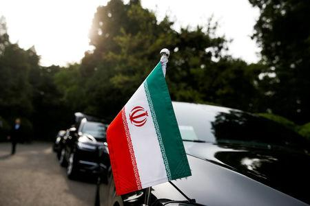 FILE PHOTO: Cars of the Iranian delegation are seen parked outside a building of the Diaoyutai state guesthouse as Iranian Foreign Minister Mohammad Javad Zarif meets Chinese State Councillor and Foreign Minister Wang Yi in Beijing, China, May 13, 2018. REUTERS/Thomas Peter/File Photo