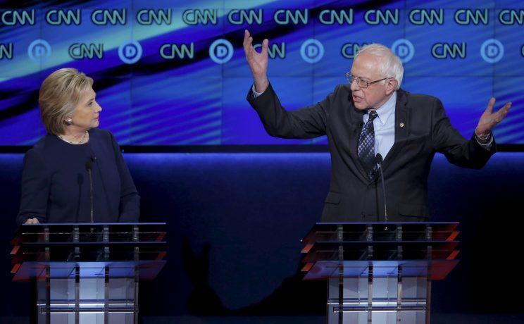 Hillary Clinton and Bernie Sanders participate during a Democratic debate in Flint, Mich., in 2016. (Jim Young/Reuters)