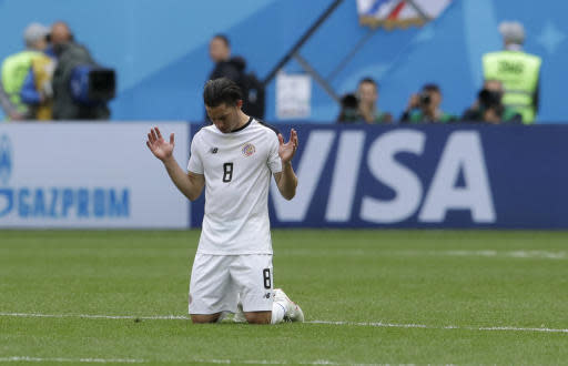 Costa Rica's Bryan Oviedo kneels on the pitch at the end of the group E match between Brazil and Costa Rica at the 2018 soccer World Cup in the St. Petersburg Stadium in St. Petersburg, Russia, Friday, June 22, 2018. (AP Photo/Petr David Josek)