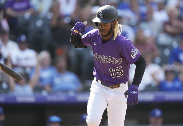 Colorado Rockies' Raimel Tapia flips his bat after hitting a two-run home run off Los Angeles Dodgers starting pitcher Max Scherzer in the fifth inning of a baseball game Thursday, Sept. 23, 2021, in Denver. (AP Photo/David Zalubowski)