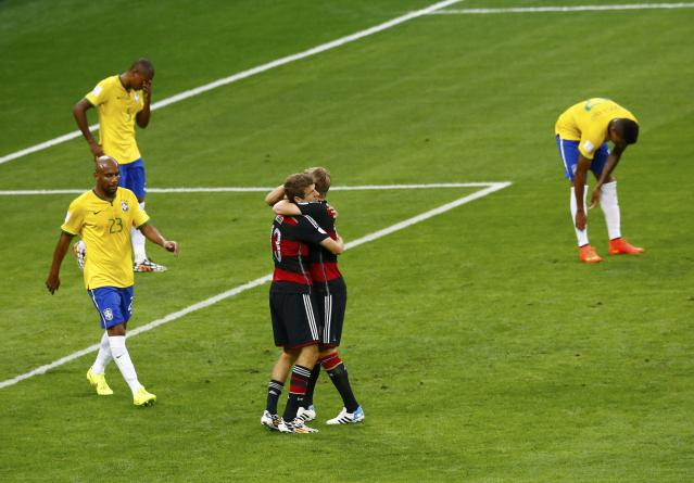 Germany's Thomas Mueller and Toni Kroos celebrate their team's second goal against Brazil during their 2014 World Cup semi-finals at the Mineirao stadium in Belo Horizonte July 8, 2014. REUTERS/Leonhard Foeger (BRAZIL - Tags: SOCCER SPORT WORLD CUP)
