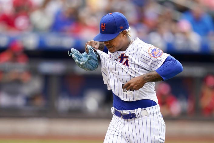 New York Mets starting pitcher Marcus Stroman walks to the dugout after being pulled during the sixth inning of a baseball game against the Cincinnati Reds, Sunday, Aug. 1, 2021, in New York. (AP Photo/Corey Sipkin)