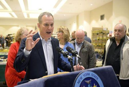 New York Attorney General Schneiderman speaks to reporters during the New Eastcoast Arms Collectors Associates Arms Fair in Saratoga Springs