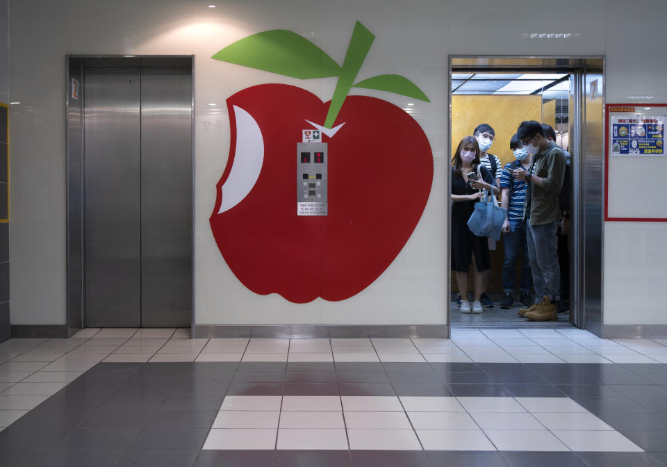 """A huge logo of Apple Daily is displayed at the lift lobby outside the news room of Apple Daily Monday, April 26, 2021. A year ago, the pro-democracy Apple Daily newspaper published a front-page headline saying Hong Kong's governing principle of """"one country, two systems is dead."""" On Thursday, June 17, 2021, the newspaper was facing its greatest peril. Three top editors and two senior executives were arrested under Hong Kong's new national security law. (AP Photo/Vincent Yu)"""