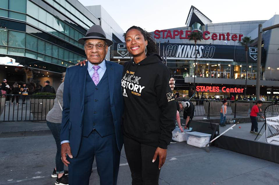 LOS ANGELES, CA - FEBRUARY 26: Willie O'Ree (L) the first black NHL player and Blake Bolden (R) the first black NWHL player pose in front of  STAPLES Center before the game between the Pittsburgh Penguins and the Los Angeles Kings on February 26, 2020 in Los Angeles, California. (Photo by Juan Ocampo/NHLI via Getty Images)