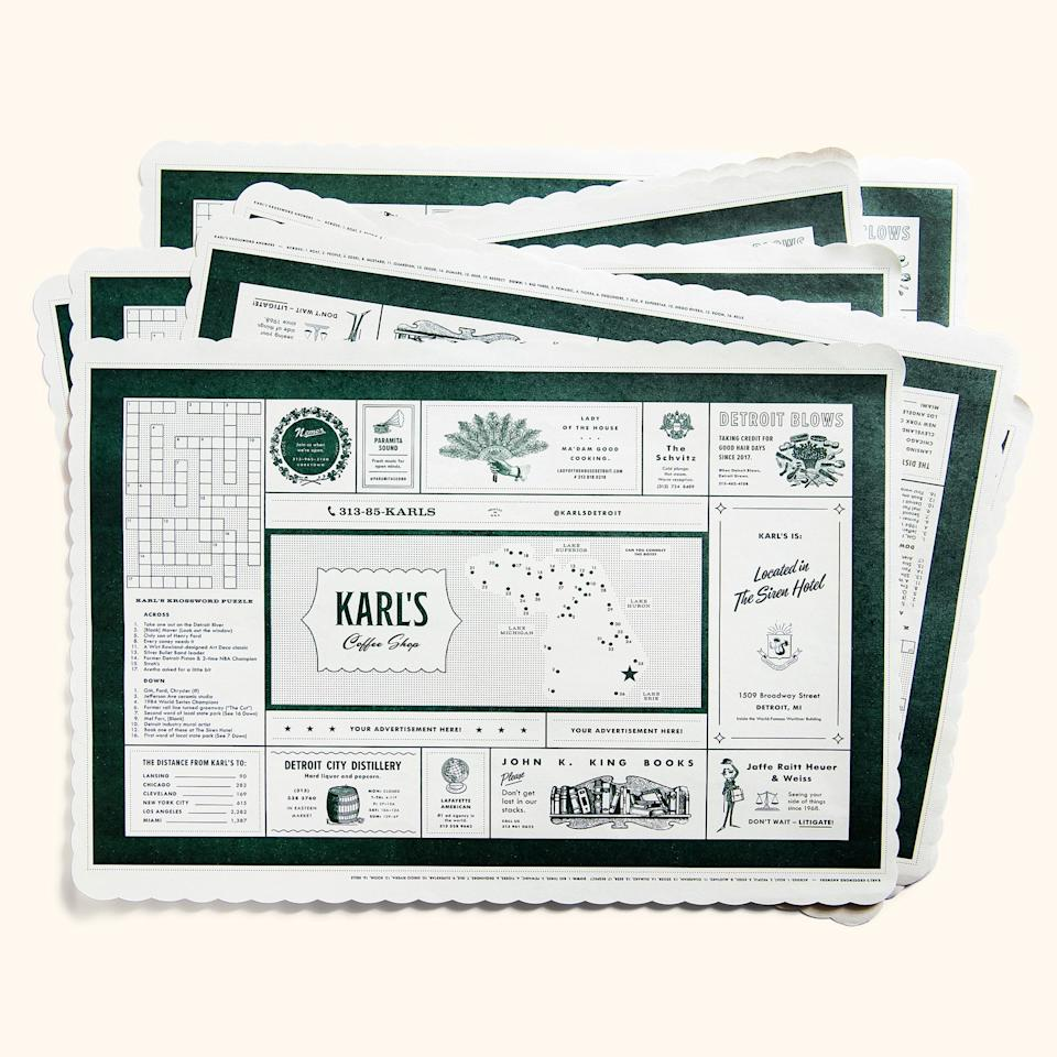 """Williams's first job, at <a href=""""http://www.guernseyfarmsdairy.com/"""" rel=""""nofollow"""">Guernsey Farms Dairy</a> in Northville, MI, had """"puke yellow placemats"""" with funeral home ads and connect-the-dots for kids. These mats are an ode to those. Race your family to see who can finish the Detroit trivia crossword puzzle first (whoever wins gets everyone's milkshake cherries). The """"ads""""— fake taglines, real places—include the restaurant's lawyers (""""don't wait, litigate!""""), a local schvitz, and Williams's favorite hair salon (<a href=""""https://www.instagram.com/detroitblows/?hl=en"""" rel=""""nofollow"""">Detroit Blows</a>: """"taking credit for good hair days since 2017"""")."""
