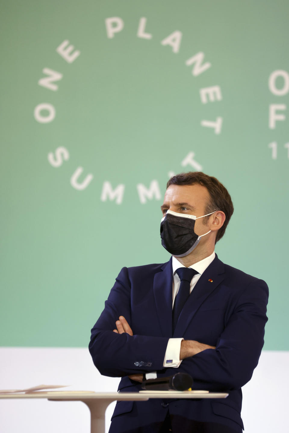 FILE - In this Jan. 11, 2021 file photo, French President Emmanuel Macron stands during the One Planet Summit, at The Elysee Palace, in Paris, France. World leaders breathed an audible sigh of relief that the United States under President Joe Biden is rejoining the global effort to curb climate change, a cause that his predecessor had shunned. (Ludovic Marin, Pool Photo via AP, File)