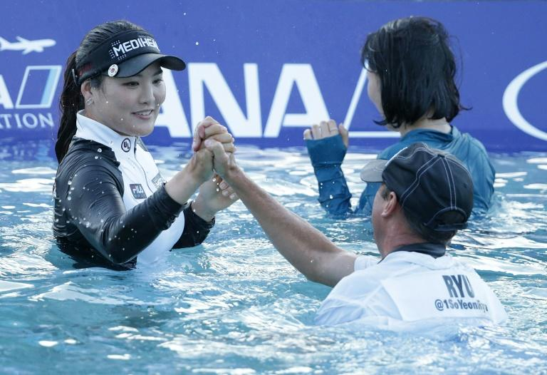 Ryu So-Yeon of South Korea celebrates with her caddie Tom Watson after defeating Lexi Thompson in a playoff during the final round of the ANA Inspiration, at Mission Hills Country Club in Rancho Mirage, California, on April 2, 2017