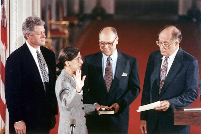 "August 10, 1993 Justice Ruth Bader Ginsburg is sworn in as an Associate Justice of the Supreme Court. From left to right stand President Bill Clinton, Justice Ruth Bader Ginsburg, Martin Ginsburg, and Chief Justice William Rehnquist. <span class=""copyright"">Collection of the Supreme Court of the United States</span>"
