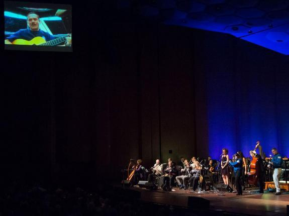Canadian astronaut Chris Hadfield (top left) and NASA astronauts Cady Coleman and Dan Burbank (in blue flight jackets) perform with the traditional Irish band The Chieftains on Feb. 15, 2013, at Jones Hall in Houston during the bands 50th anniv