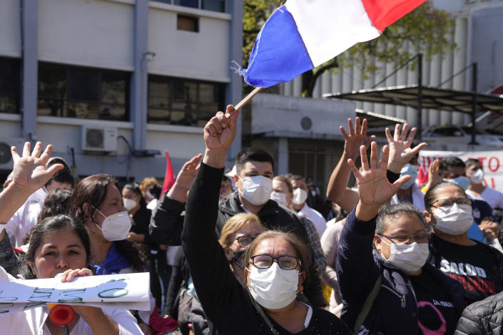 Health workers protest for better salaries and the renewal of their contracts outside the Health Ministry in Asuncion, Paraguay, Thursday, Sept. 9, 2021, during the COVID-19 pandemic. (AP Photo/Jorge Saenz)