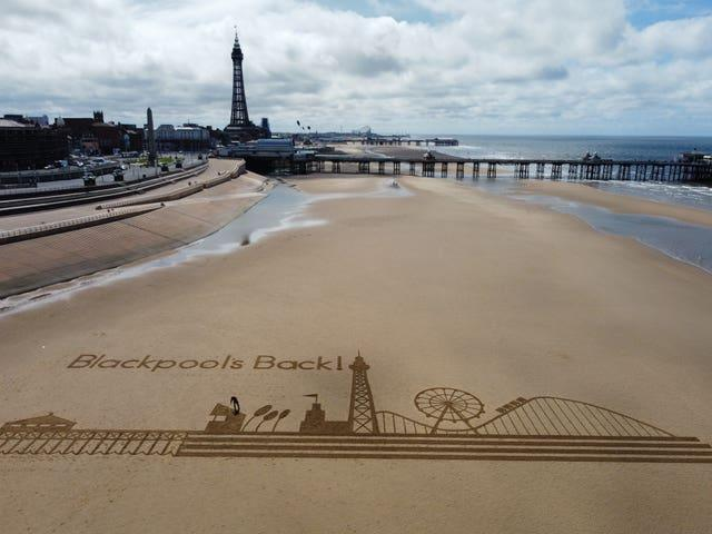 Sand art on the beach as Blackpool's indoor attractions, hotels and guesthouses, show venues, and indoor hospitality reopen (Peter Byrne/PA)