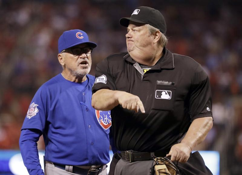 Chicago Cubs manager Joe Maddon, left, is ejected by home plate umpire Joe West during the ninth inning of a baseball game against the St. Louis Cardinals, Monday, Sept. 12, 2016, in St. Louis.
